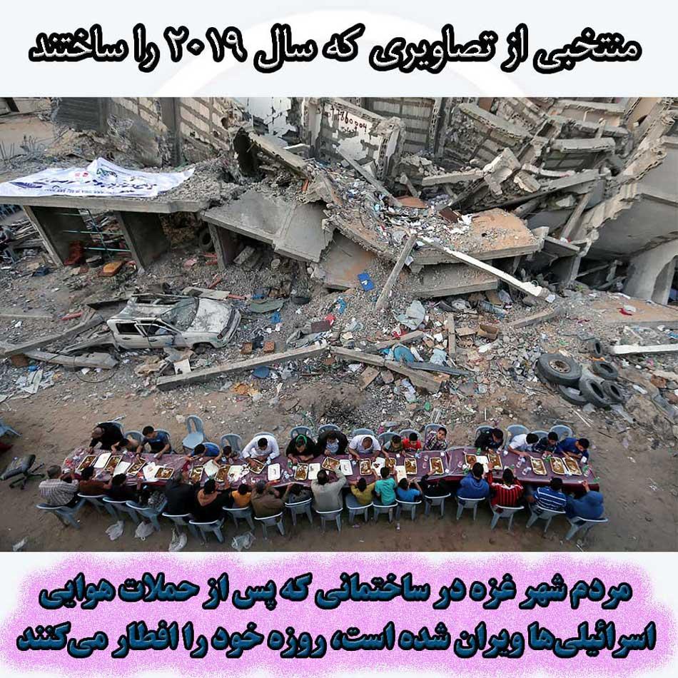 مردم شهر غزه در ساختمانی که اخیراً در حملات هوایی اسرائیلیها ویران شده است، روزه خود را افطار میکنند.